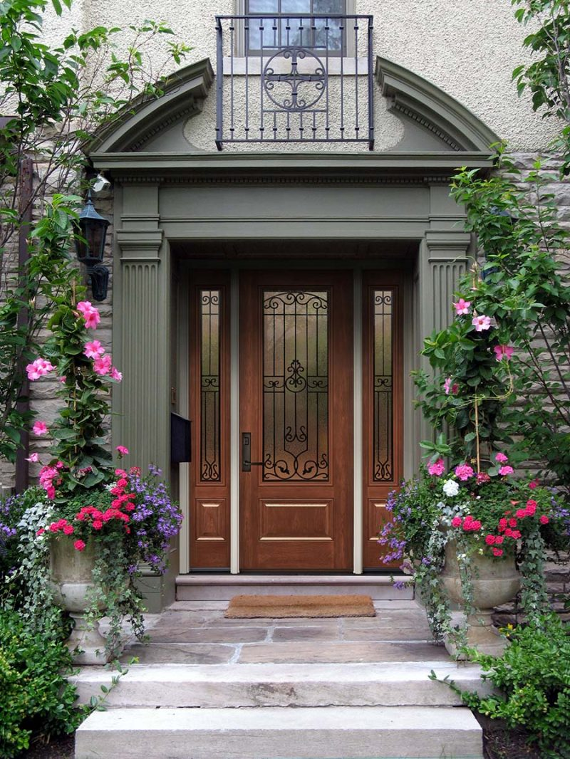 beautiful front door with flowers